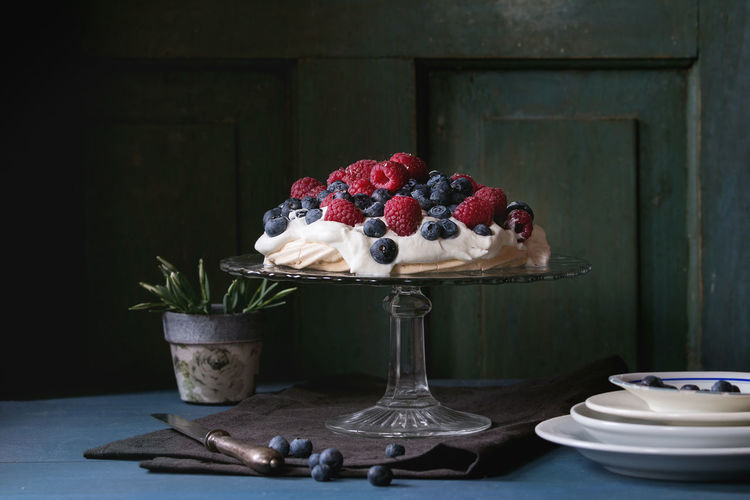 Fruit cake on stand over table