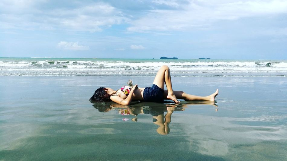 Young lady sunbathing to achieve tan complexion. Sommergefühle EyeEmNewHere Sunbathing☀ Real Life Beachlovers Clouds And Sky Reflections