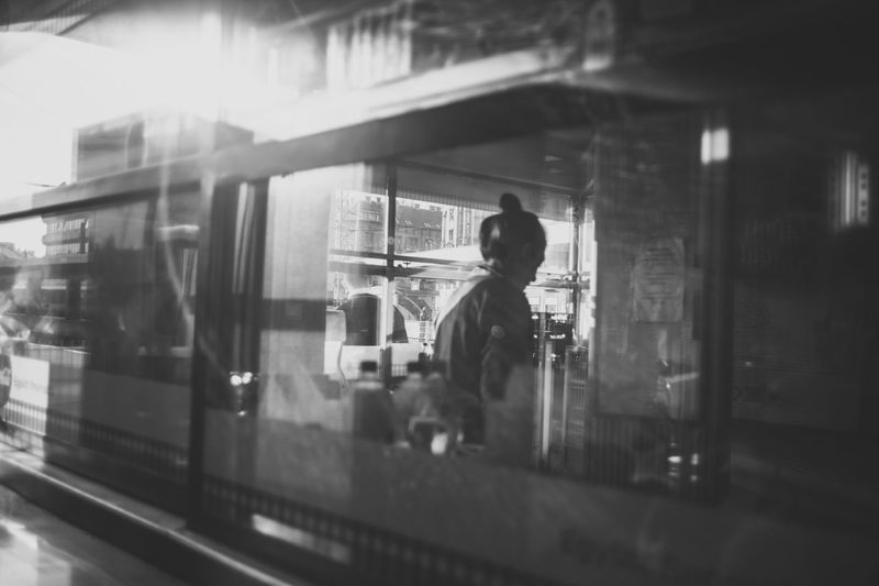 Blackandwhite Blurred Motion City Life Contemporary Depth Of Field Glass - Material Illuminated Incidental People Real People Restaurant Selective Focus Streetphoto_bw Streetphotography Transparent Window Women