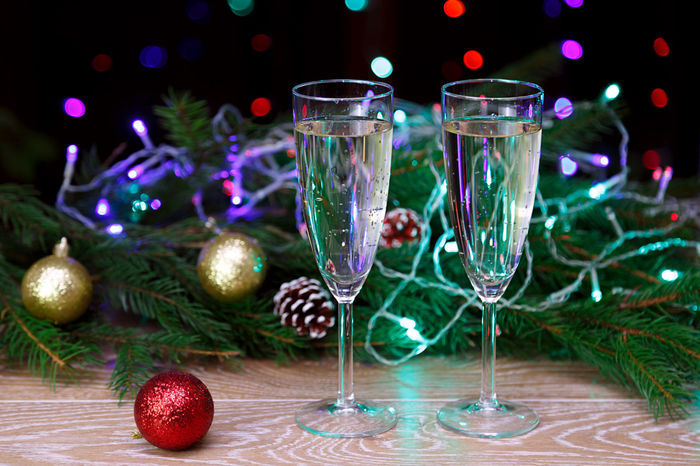 Christmas Illuminated Multi Colored Christmas Ornament Christmas Lights Night New Year Christmas Eve Alcohol Drinks Champagne Toast Bubbly Cheers Beverage Wine Drinking Glass Drink Holding Alcohol Bokeh Effect Mery Christmas Christmas Spirit Bokeh Celebration Christmas Party