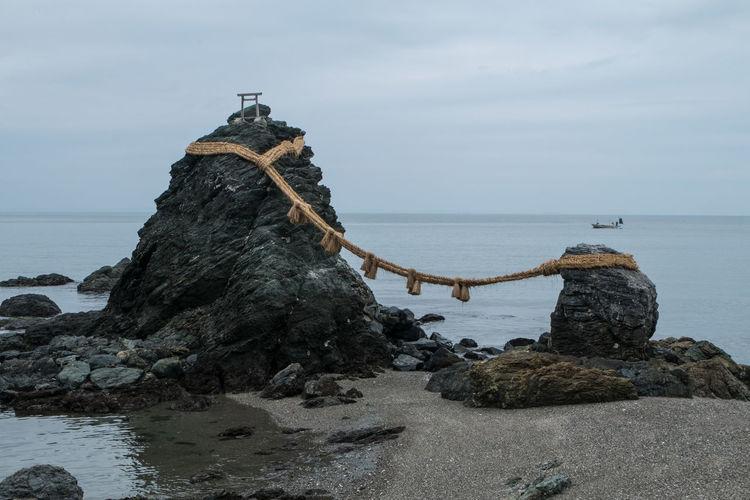 Rope Tied On Rocks On Beach
