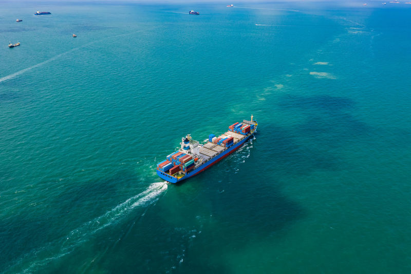 High angle view of shipping container sailing in sea