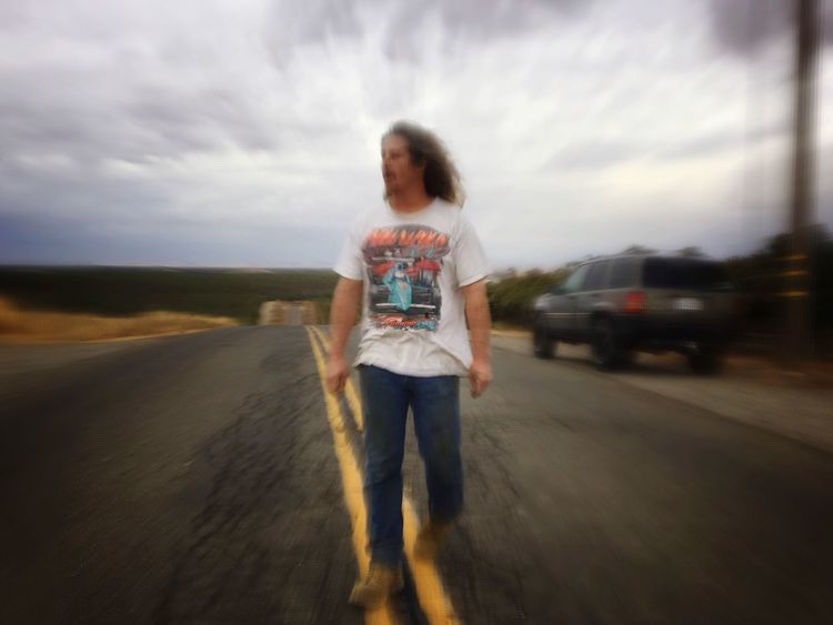 Standing Full Length One Person Casual Clothing Real People Front View Outdoors Day Sky Childhood Cloud - Sky California On The Road Motion Blur Mustang Mike In The Middle Of Nowhere (null)Countryside Glamour