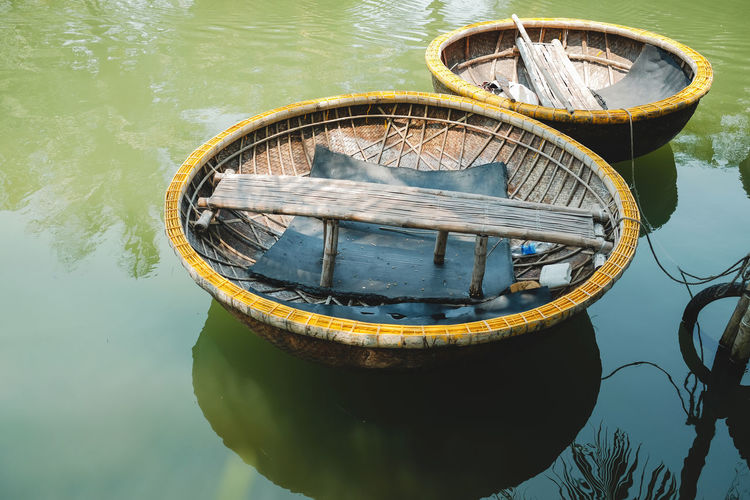 Traditional Round Basket Boat at the Pier. Favorite Activities for Tourist in Hoi An, Vietnam Water Nautical Vessel Transportation Reflection Nature Mode Of Transportation No People Day Lake Moored Waterfront Outdoors Sunlight Yellow Floating Floating On Water Geometric Shape Wood - Material Rowboat Nautical Equipment Wheel Boat Travel Vietnam Basket Boat Hoi An, Vietnam Traditional River Vacations Tourist Fun