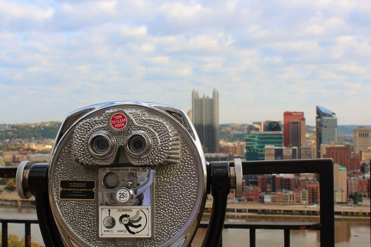 Let's look at the history Cityscape Building Exterior City Coin-operated Binoculars Architecture Built Structure Sky Binoculars Travel Destinations Cloud - Sky Skyscraper No People Outdoors Urban Skyline Day Close-up Technology Pittsburgh