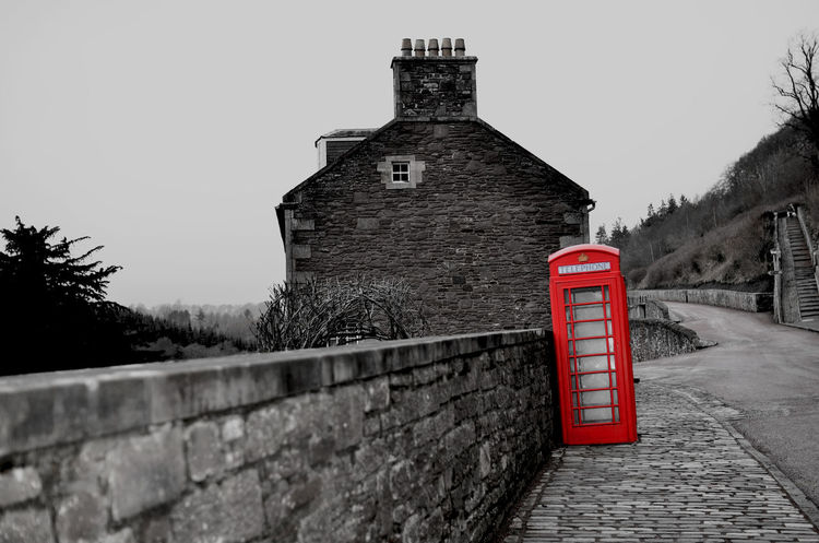 New Lanark in Scotland Architecture Black & White Black And White Black And White Photography Blackandwhite Brick Wall Built Structure Deserted Exterior History No People Old Buildings Post Box  Red Red Post Box Spot Color Stone Wall Stone Walls Surrounding Wall The Past