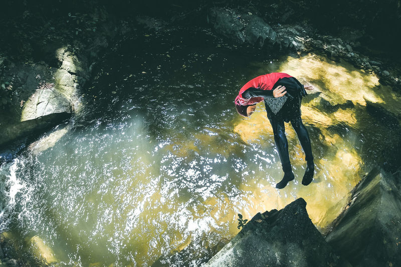 High Angle View Woman Jumping In Water