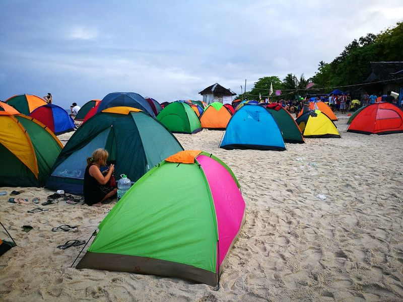Tent Beach Camping Multi Colored Sand Vacations Day Sky Outdoors Nature Summer Leisure Activity Shelter Adults Only People Only Men One Man Only Adult The Great Outdoors - 2017 EyeEm Awards EyeEmNewHere Eyeem Philippines EyeEm Phillippines Breathing Space