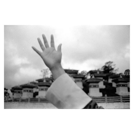 Touch Faith | 108 Stupa of DochulaPass 30km from Thimphu Bhutan | LeicaM6 35mm Kodak TriX blackandwhite film | leica documentary travel Buddhism | analogphotography landscape ig_bhutan