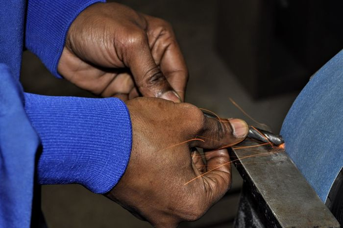 Hands At Work Drill Grinding Sharpening Metal