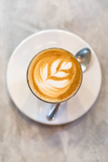 Top view, cup of coffee latte Refreshment Drink Coffee Coffee - Drink Coffee Cup Food And Drink Mug Cup Still Life Frothy Drink Saucer Table Hot Drink Crockery High Angle View Cappuccino No People Freshness Indoors  Froth Art Latte Breakfast