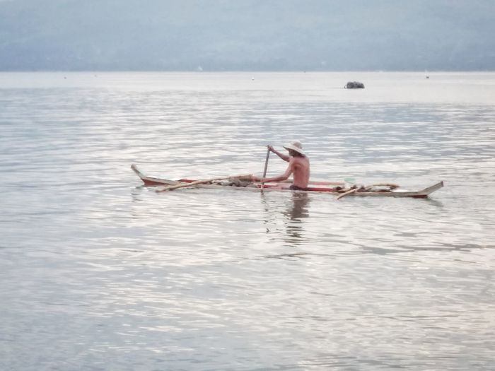 Risk taker Nautical Vessel Transportation Adult Water One Man Only One Person Outdoors Oar Rowing People Subic Bay Rural Scene Eyeem Philippines Bravery Risk Taker Banka High Key Photography At Sea Rowing Be. Ready. Real People Horizon Over Water Sea Nature Day Leisure Activity Beauty In Nature Waterfront Sky The Photojournalist - 2018 EyeEm Awards