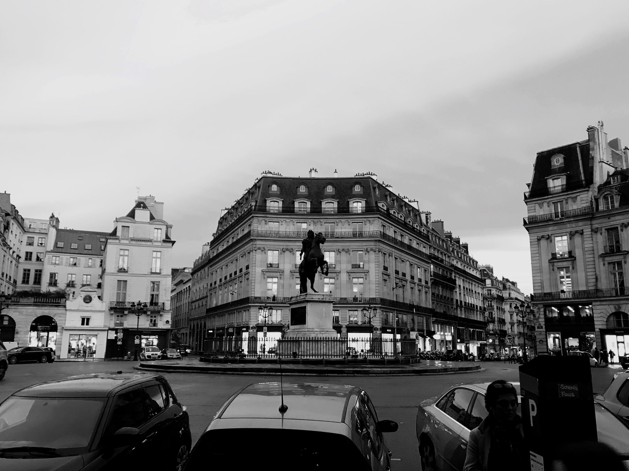 architecture, building exterior, built structure, car, land vehicle, mode of transport, sky, statue, transportation, city, travel, travel destinations, outdoors, sculpture, day, large group of people, real people, people