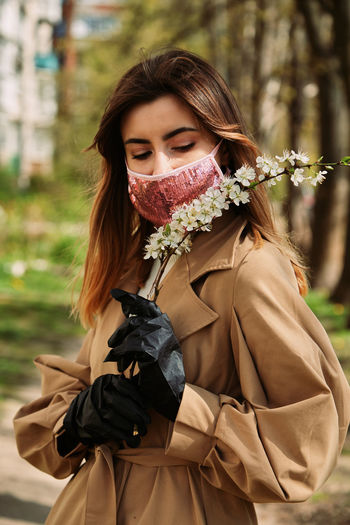 Young woman wearing mask outdoors