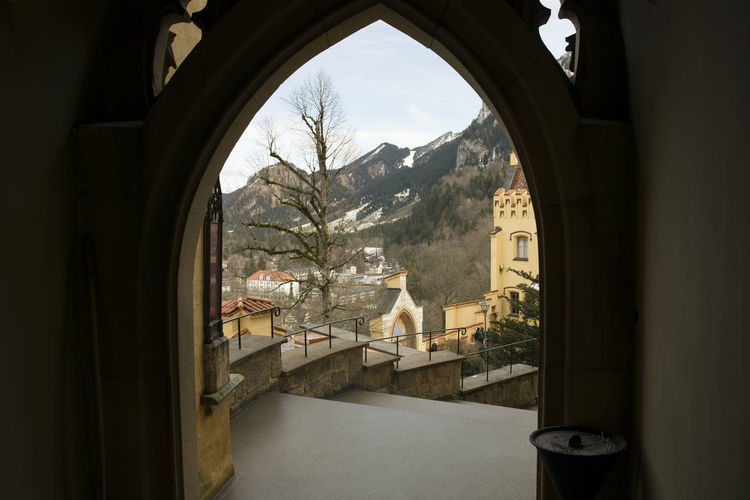 Buildings and mountain seen from doorway