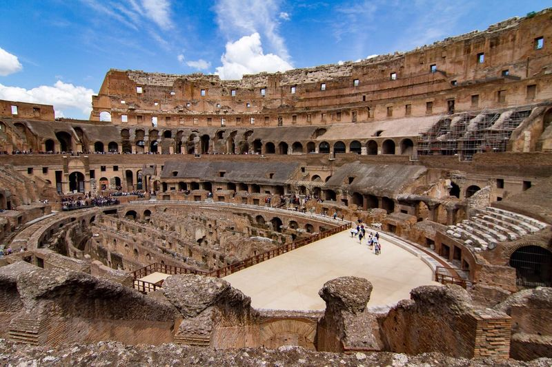 Roma Italy Coliseum Roman Old Buildings Wide Shot Travel Destinations Outdoors Cloud - Sky Architecture Tourism Famous Place Capital Cities  History Monument