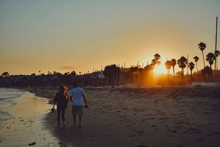 • S a n t a B a r b a r a • Sunset Beach Full Length Togetherness Real People Men Lifestyles Walking Vacations Rear View Women Nature Beauty In Nature Sun Sea Sunlight Weekend Activities Outdoors Sand Couples Love Ocean California SoCal Santa Barbara