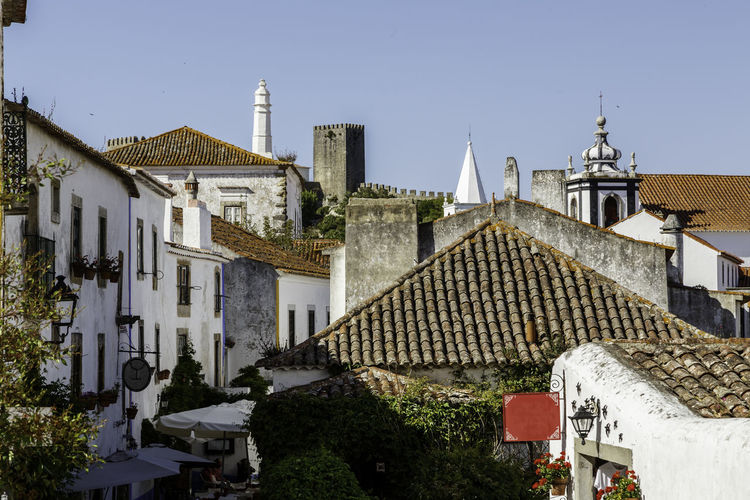 Architecture Bell Tower Building Exterior Built Structure Clear Sky Day No People Outdoors Place Of Worship Roof Sky The Architect - 2017 EyeEm Awards Tiled Roof  Town Tree Óbidos