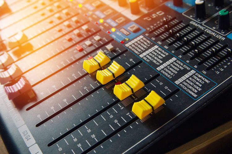 button volume on mixer in dj studio Close-up Communication Computer Control Panel Day Indoors  Music No People Recording Studio Sound Mixer Sound Recording Equipment Technology Yellow