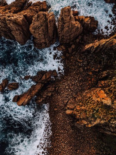 Love this spot for the contrasting orange and blue of the rocks and ocean. It was only natural to shoot it from the air with the drone. IG @noeldxng Water Backgrounds Beach Full Frame Sand Close-up Sky Rushing Shore Sandy Beach Ocean Seaside Rocky Coastline Surf Rock Formation Rugged Textured  Power In Nature Wave Rough The Great Outdoors - 2018 EyeEm Awards