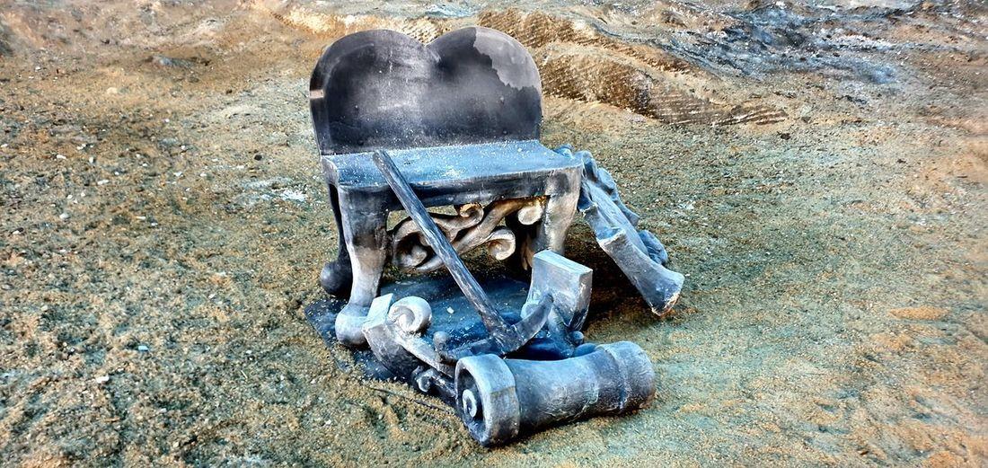 High angle view of rusty machine on field