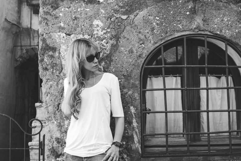 Architecture Black And White Blackandwhite Photography Building Exterior Built Structure Casual Clothing Day House Leisure Activity Lifestyles One Person Outdoors People Portrait Portrait Of A Woman Real People Standing Window Young Adult Young Women Blonde Hair The Portraitist - 2017 EyeEm Awards