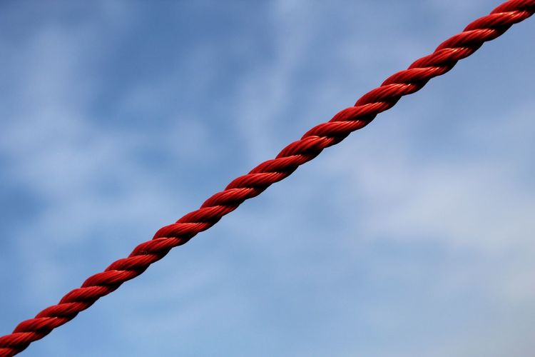 Low angle view of a plastic rope against sky