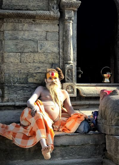 Hinduism devotee Street Photography Devotee Hinduism Devotee Hinduism Human Representation Sitting Full Length Built Structure Architectural Column Statue Building Exterior Architecture Spirituality Outdoors Day Sculpture Place Of Worship Real People People One Person