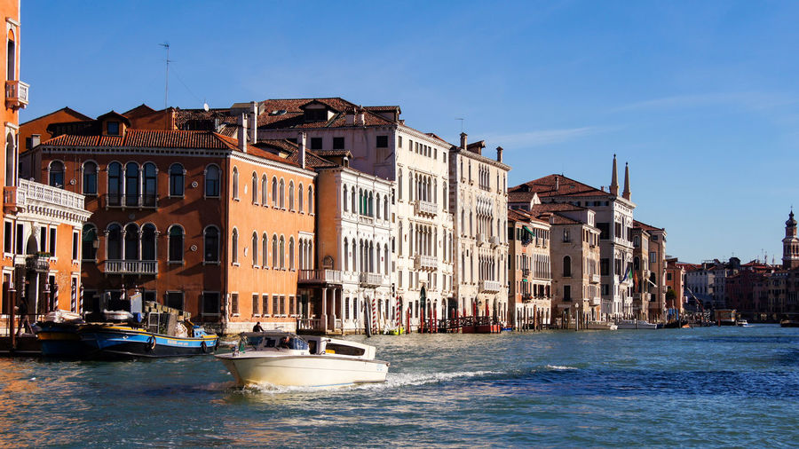 Canal Grande Canal Grande Venice, Italy Architecture Blue Building Building Exterior Built Structure Canal City Clear Sky Day Incidental People Mode Of Transportation Motorboat Nautical Vessel Outdoors Residential District Sea Sky Transportation Water Waterfront