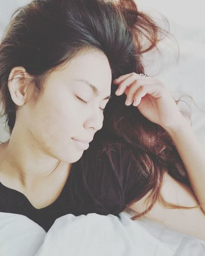 Close-up of woman sleeping on bed