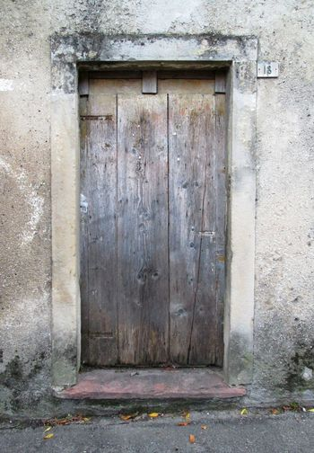 Ancient wood door Door Wood Ancient Architecture Scratched Background Architectural Detail Entrance Ruined Building Concretewalls Gray