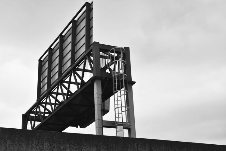 EyeEmNewHere Built Structure Low Angle View Billboard Behindthescenes Noir Monochrome