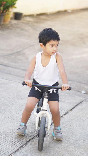 Full length of boy riding bicycle