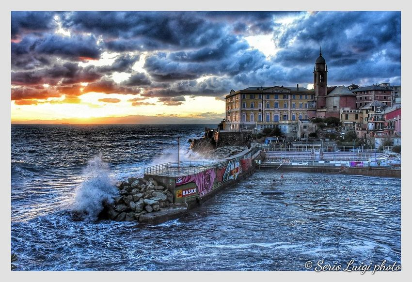 La tempesta si sta per placare al sorgere del sole, porticciolo di Genova Nervi Afterstorm  Sunset Waves Skyandsea Seastorm Water Nautical Vessel Sea Wave Beach Sunset Sky Architecture Horizon Over Water Building Exterior