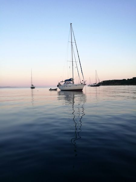 Sea Reflection Tranquility Water Tranquil Scene Nature Outdoors Dawn Light Sailboat At Sea Sailboats⛵️️ Lost In The Landscape