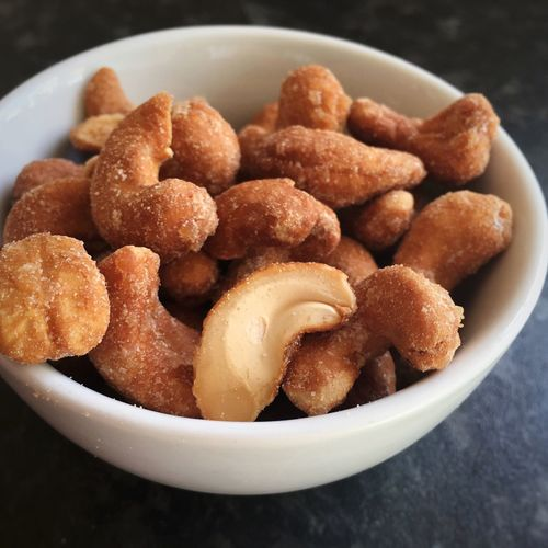 Close-up of roasted honey cashew in bowl
