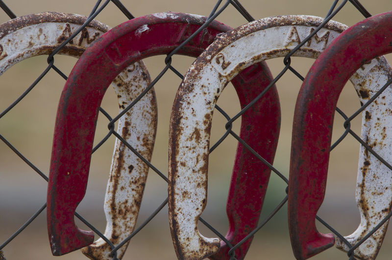 Chain Close-up Connection Day Fence Focus On Foreground Hanging Horse Shoes Metal Metallic No People Outdoor Games Outdoors Red Rusty