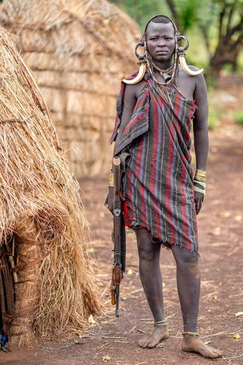 Mursi Tribe Village, woman warrior in Ethiopia Mursi Mursi Village Mursitribe Mursiwoman Tribe Omo Valley Tribal Ethiopia Portrait Of A Woman Africa Ethiopian Ethiopian Photography 🇪🇹 Portrait Photography African Portraits Travel Clothing One Person Traditional Clothing Adult Standing Full Length Outdoors Front View Walking Nature Focus On Foreground Portrait Real People Looking At Camera