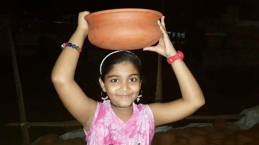 Girl with Clay Crock Pot Crock Pot Clay Utensil Earthernpots Girl Power EyeEm Nature Lover EyeEm Gallery Eyeem Market Getty Images Getty+EyeEm Collection Gettyimagesgallery Getty Images Premium Collection EyeEm Selects EyeEm Portrait Of A Woman Asian Girl Indian Casualphotography EyeEm Masterclass EyeEm The Best Shots Nightphotography Girl Posing For Photo Pottery Art Pottery Display Clay Pottery Pieces Child Portrait Black Background Girls Childhood Representing