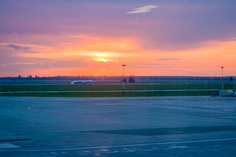 Sunset Sky Orange Color Cloud - Sky Nature Beauty In Nature No People Scenics - Nature Airport Street Transportation Road Outdoors Environment Sport Landscape Airplane Air Vehicle Airport Runway Tranquil Scene