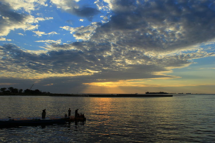 Twilight sky on Losari beach Sky Water Sunset Cloud - Sky Scenics - Nature Beauty In Nature Nautical Vessel Tranquility Transportation Tranquil Scene Waterfront Sea Mode Of Transportation Silhouette Nature Orange Color Reflection Idyllic Outdoors