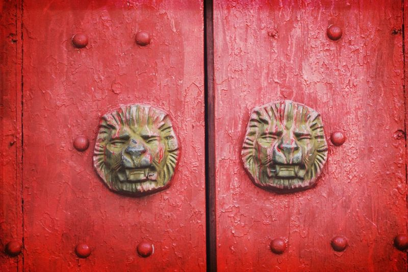 Door knocker on red door