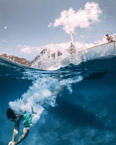 Man swimming and diving in sea