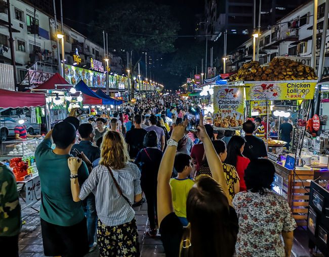 Group of people on street market at night