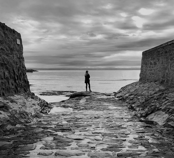 Full Length Sea Sky Real People Water One Person Outdoors Standing Cloud - Sky Men Nature Leisure Activity Scenics Horizon Over Water Beauty In Nature Adventure Beach Day Wave Adult Blackandwhite Black & White Blackandwhite Photography