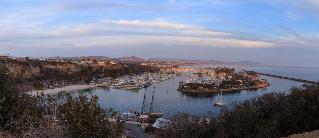 Panoramic Dana Point harbor view of the sunset and a private beach below Boats California City Cloud - Sky Dana Point, Ca Day Harbor View Mountain Nature Nautical Vessel No People Outdoors Sky Sunset Tree Water