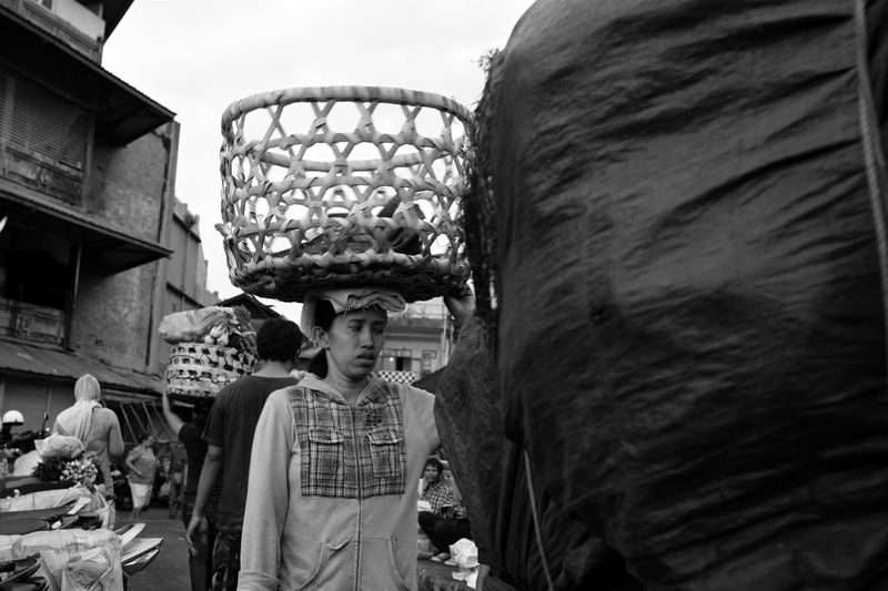 the daily grind at the pasar ASIA Asian Culture B&w Photography B&w Street Photography Bali Bali, Indonesia Balinese Balinese Life Basket On The Head Carrying Things On The Head Everybodystreet Everydayasia Fujifilm_xseries Human Interest Hustle And Bustle Indonesia_photography Market Scene Monochrome Street Photography Street Portrait Streetphotography Tourist Destination Traditional Culture Traditional Market Woman Walking The Street Photographer - 2017 EyeEm Awards