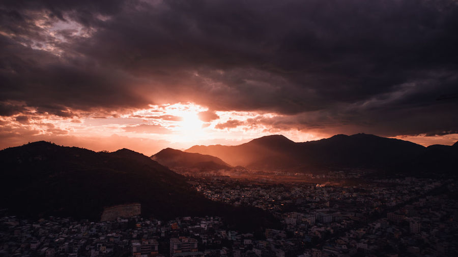 Nha Trang cityview on sunset Architecture Beauty In Nature Building Building Exterior Built Structure City Cityscape Cloud - Sky Crowded Dramatic Sky Environment High Angle View Mountain Mountain Range Nature Outdoors Scenics - Nature Sky Sunset TOWNSCAPE