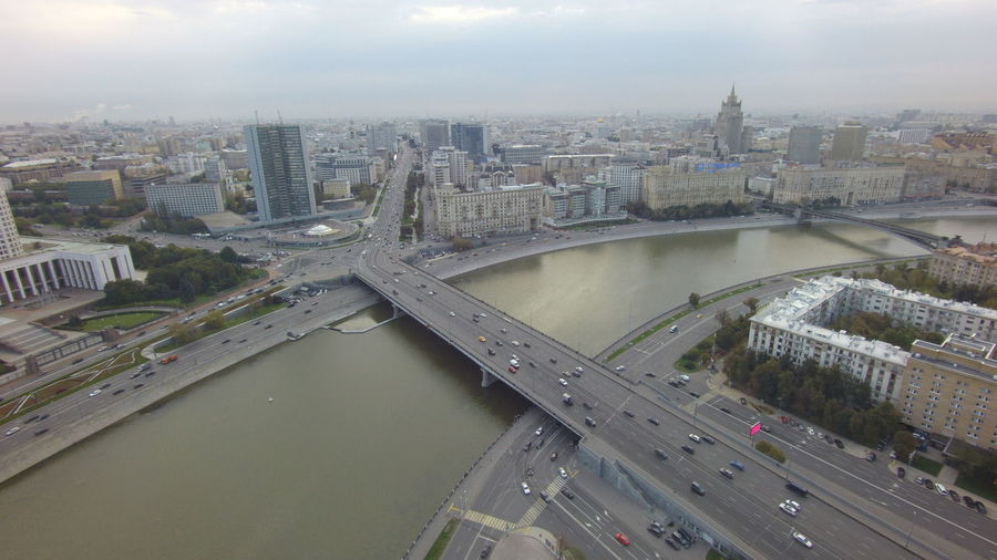 Aerial View Of Bridge Over River Against Sky In City
