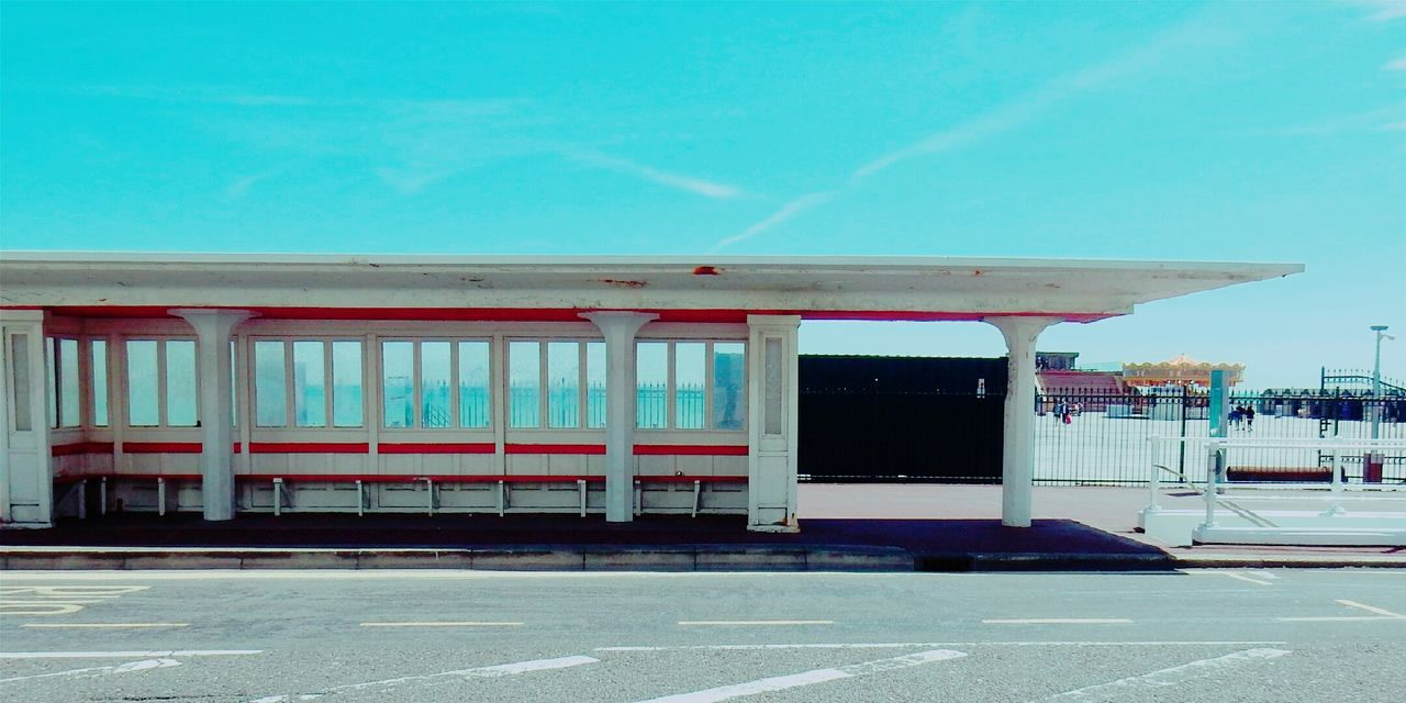 built structure, empty, day, transportation, no people, architecture, blue, station, outdoors, clear sky, sky, pay phone